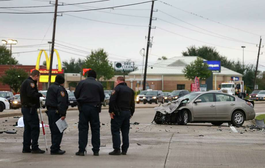 Harris County Sheriff's Office deputies investigate the scene of a two-vehicle crash on the intersection of Barker Cypress Road and FM 529 Thursday, Nov. 9, 2017, in Houston. One person was killed in the crash. Photo: Godofredo A. Vasquez, Houston Chronicle / Houston Chronicle