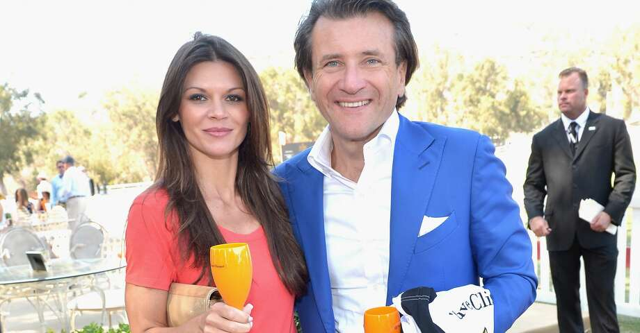 """Actress Danielle Vasinova (L) and """"Shark Tank"""" investor Robert Herjavek attend the Fifth-Annual Veuve Clicquot Polo Classic at Will Rogers State Historic Park on October 11, 2014 in Pacific Palisades, California.  (Photo by Charley Gallay/Getty Images for Veuve Clicquot) Photo: Charley Gallay/Getty Images For Veuve Clicquot"""