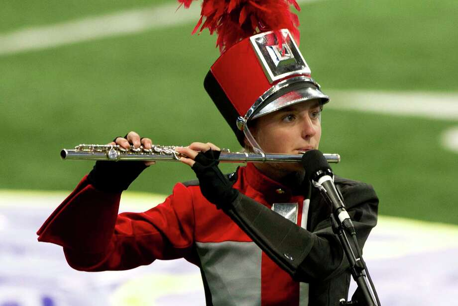 A flute player with the Tomball High School band performs during the UIL Marching Band State Championships at the Alamodome, Wednesday, Nov. 8, 2017, in San Antonio. Photo: Jason Fochtman, Staff Photographer / © 2017 Houston Chronicle