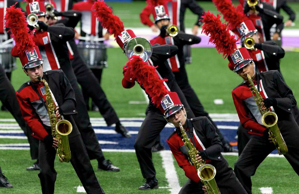 Members of the Tomball High School band compete during the UIL Marching Band State Championships at the Alamodome, Wednesday, Nov. 8, 2017, in San Antonio.