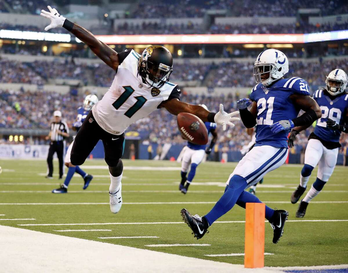 Jacksonville Jaguars wide receiver Marqise Lee (11) looses the ball out-of-bounds after a catch in front of Indianapolis Colts cornerback Vontae Davis (21) during the first half NFL football game in Indianapolis, Sunday, Oct. 22, 2017. (AP Photo/Jeff Roberson)