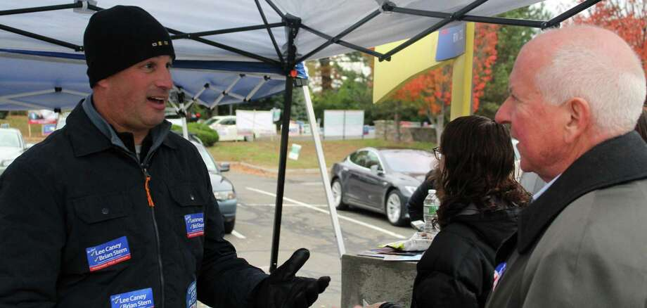 Lee Caney and Jim Marpe speak outside of the polling place at Sagautck Elementary School on election day. Photo: Sophie Vaughan/Hearst Connecticut Media