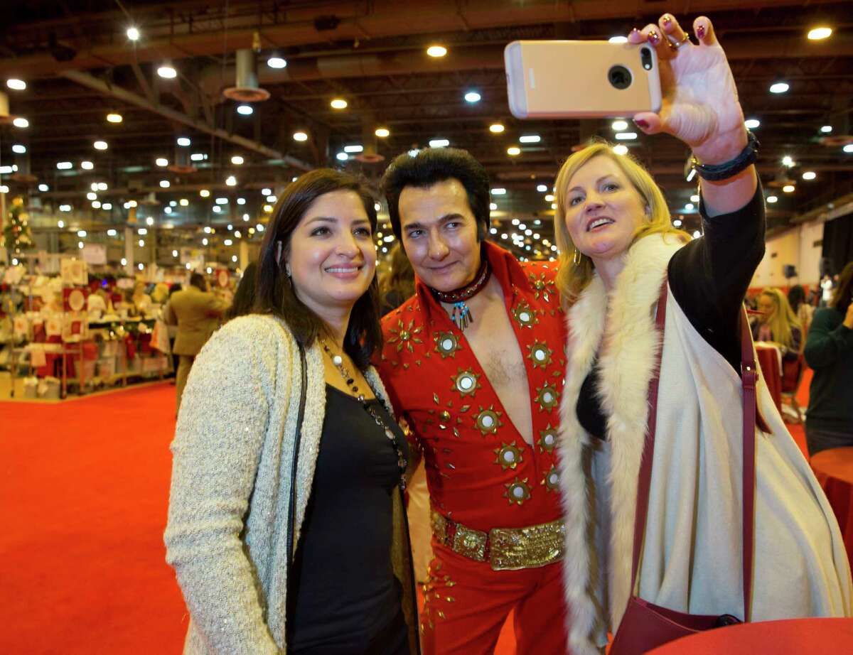 People attend the Wells Fargo Preview Party for the Houston Ballet Nutcracker Market on Wednesday, Nov. 8, at NRG in Houston.
