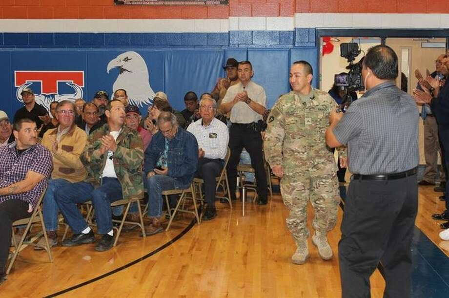 Sgt. Juan Ramos, who had been deployed overseas, enters the Veterans Day Program at Trautmann Middle School on Wednesday much to the surprise of attendees.  Photo: Courtesy