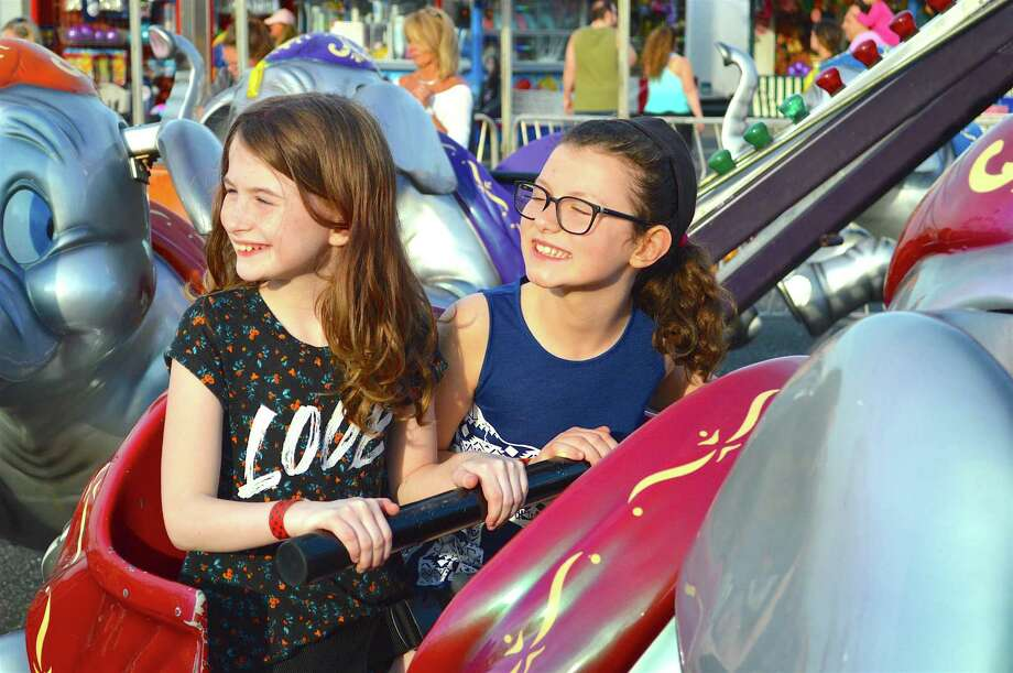 Maya Knutson, 9, left, and Mollie Micinilio,9, of Fairfield, enjoy a ride together at the McKinley School Carnival at Jennings Beach, Friday, April 28, 2017, in Fairfield, Conn. Photo: Jarret Liotta / For Hearst Connecticut Media / Fairfield Citizen News Freelance