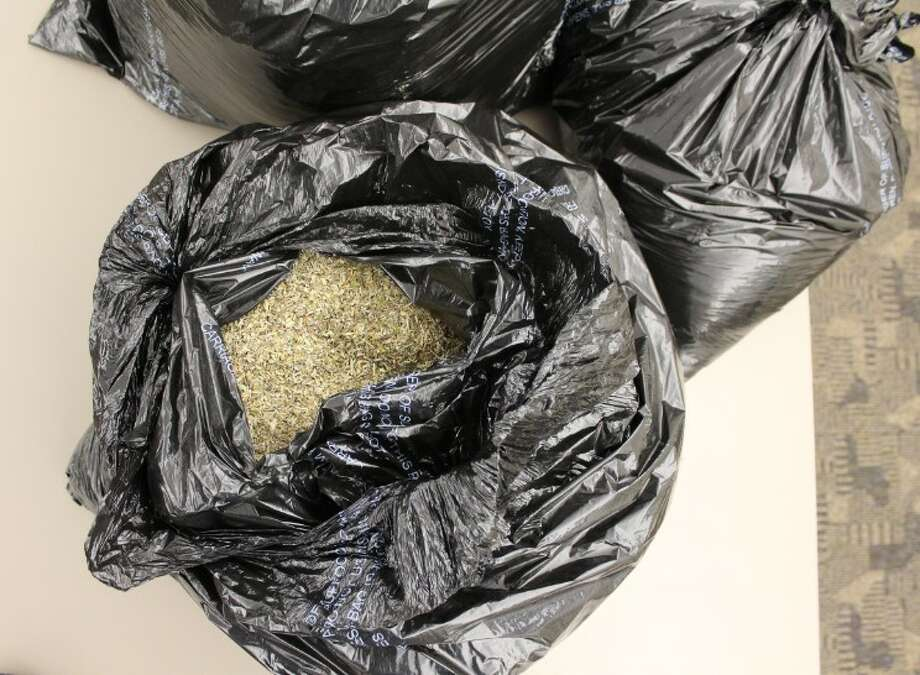 Austin police seized more than 163 pounds of synthetic marijuana concealed in several large trash bags. Photo: Contributed Photo