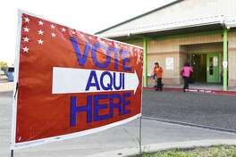 Voters enter and exit the Don Jose Gallegos Elementary voting site on Thursday, Nov. 7, 2017.