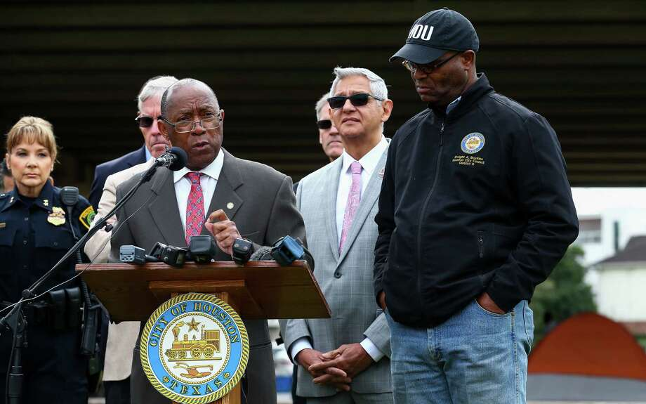 Mayor Sylvester Turner, center, speaks during a press conference addressing violence issues at the homeless encampment under the Interstate 69 highway overpass Thursday, Nov. 9, 2017, in Houston. There's been a string of shootings and a stabbing in the past three months, including a homeless man who was shot and killed Tuesday night. Photo: Godofredo A. Vasquez, Houston Chronicle / Houston Chronicle