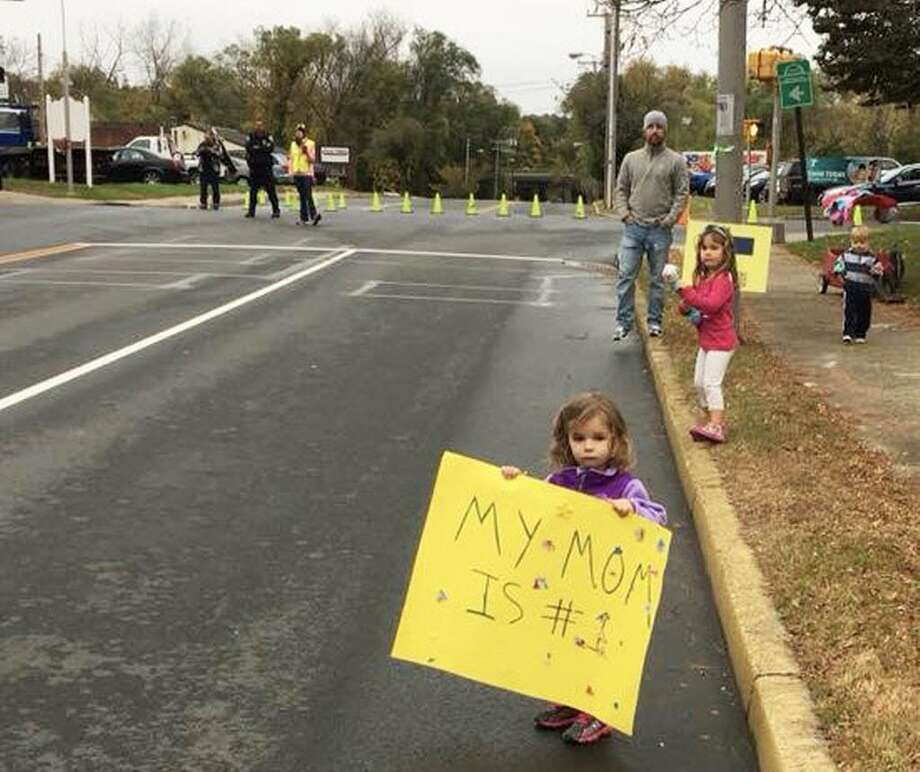 """This is too sweet not to print,"" said Melissa, whose 2-year-old daughter Brielle cheered on her mother during the Hartford Marathon Foundation Movember 5K race Sunday morning. She held a sign saying, ""My mom is #1"" on deKoven Drive during the Middletown portion of the race. Mom placed 298th out of 415 racers, 165th of 258 females and 16th out of 23 women in her division. Photo: Contributed Photo"