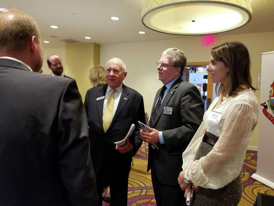 "Westport First Selectman Jim Marpe, Westport-Weston Chamber of Commerce Executive Director Matthew Mandell, and Westport Operations Director Sara Harris speak with prospective business-people at the ""Fairfield Five"" showcase in Manhattan Nov. 2. Photo: Contributed Photo"