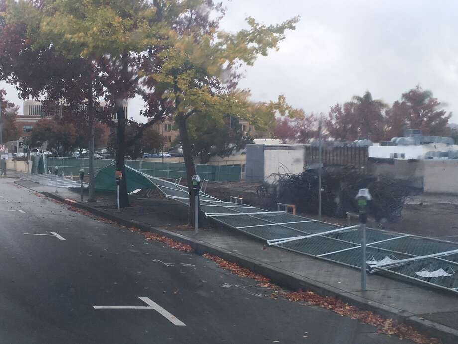 Winds early Nov. 9 apparently knocked down fencing at a fire station construction site in San Rafael.  Photo: Bill Disbrow