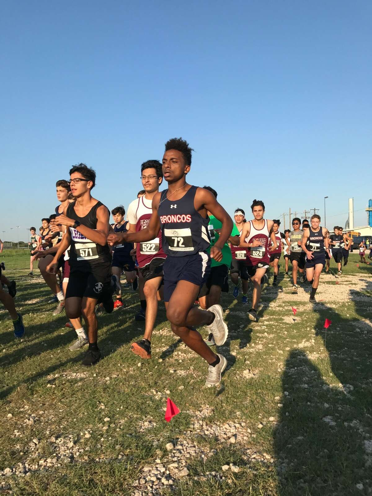 Bay Area Christian's Habtamu Geta (right) peaked at the right time in winning the TAPPS Class 4A boys' individual state cross country title recently in Waco.