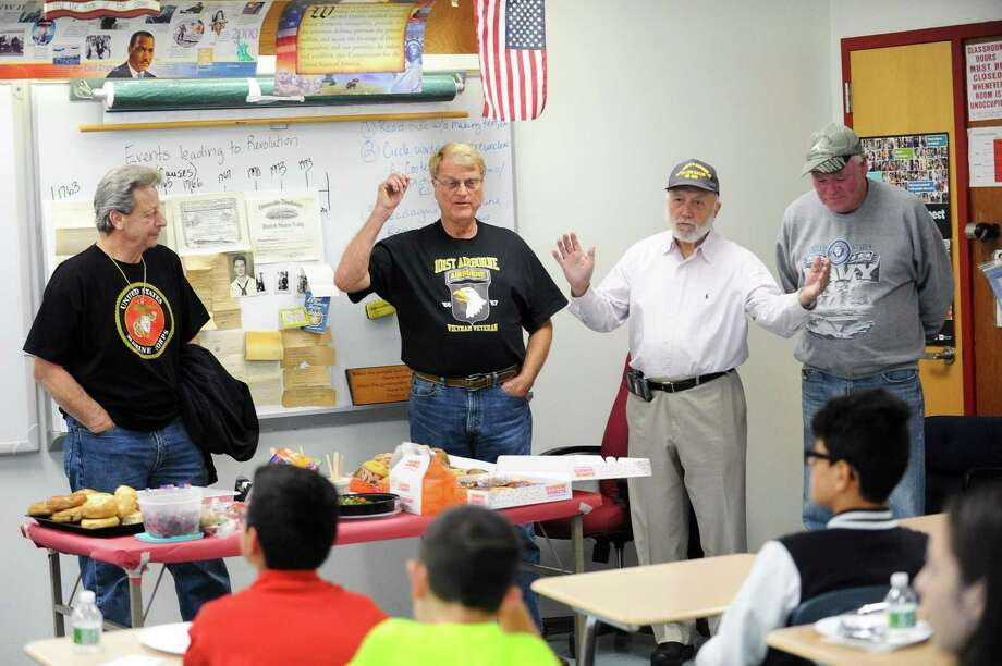 Veterans, from left, Anthony DiGiacomo (marines), Alan Nielsen (army), Bob Barker (navy) and Terrance McGrath (navy) compare their wartime experiences while speaking with students of Turn of River Middle School during the school's Veterans Day celebration in Stamford, Conn. on Thursday, Nov. 9, 2017. Photo: Michael Cummo / Hearst Connecticut Media / Stamford Advocate