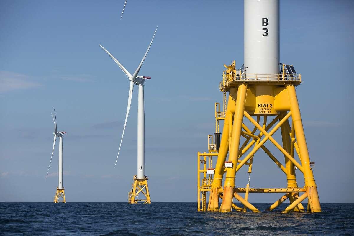 Three of Deepwater Wind's turbines stand in the water off Block Island, Rhode Island.