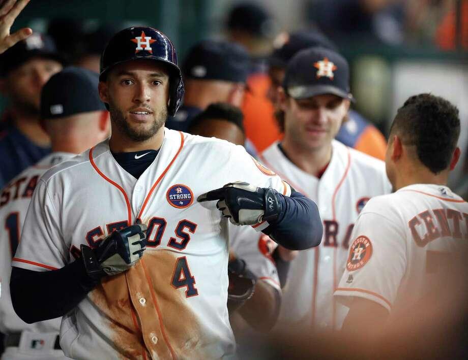 "Houston Astros George Springer (4) points to his ""Houston Strong"" patch after hitting a two-run home run in the second inning of an MLB baseball game at Minute Maid Park, Saturday, Sept. 2, 2017, in Houston.  This is the first professional sporting event in the city since Tropical Storm Harvey. ( Karen Warren / Houston Chronicle ) Photo: Karen Warren, Houston Chronicle / Internal"