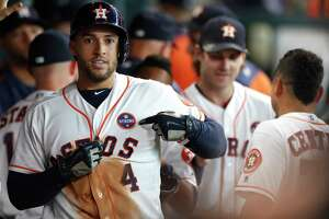 """Houston Astros George Springer (4) points to his """"Houston Strong"""" patch after hitting a two-run home run in the second inning of an MLB baseball game at Minute Maid Park, Saturday, Sept. 2, 2017, in Houston.  This is the first professional sporting event in the city since Tropical Storm Harvey. ( Karen Warren / Houston Chronicle )"""