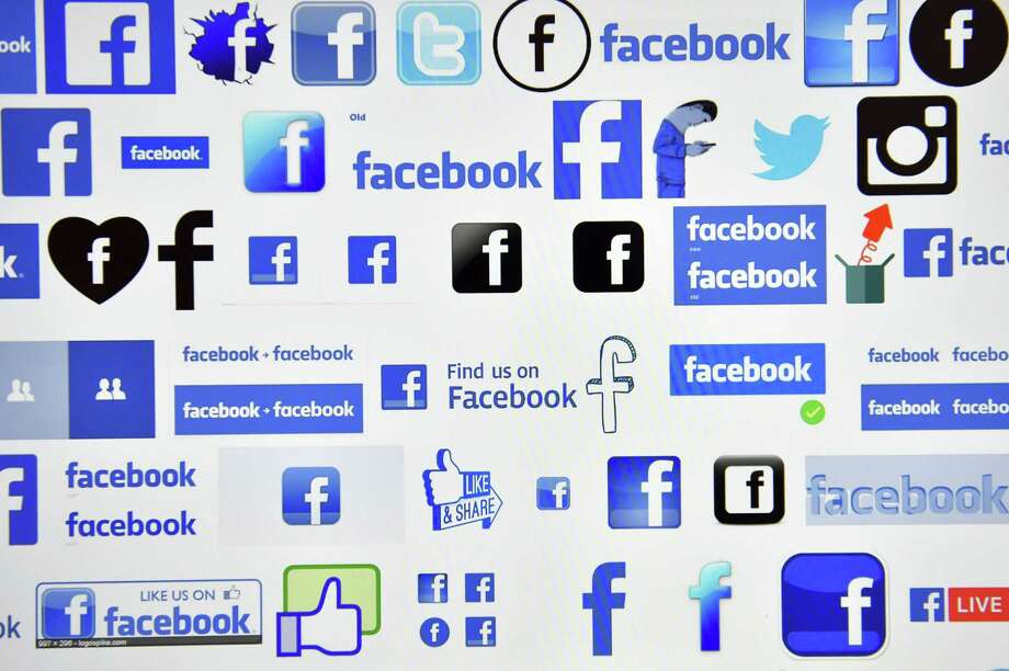 "This file photo taken on December 28, 2016 shows logos of US online social media and social networking service Facebook in Vertou, France. Facebook on April 5, 2017 unleashed a new weapon in the war against ""revenge porn"" at the leading social network as well as the messaging services Messenger and Instagram. When intimate images shared on Facebook without permission are reported, confirmed and removed, the company will use photo-matching technology to prevent copies from being shared on its platform anew. Photo: LOIC VENANCE /AFP /Getty Images / AFP or licensors"