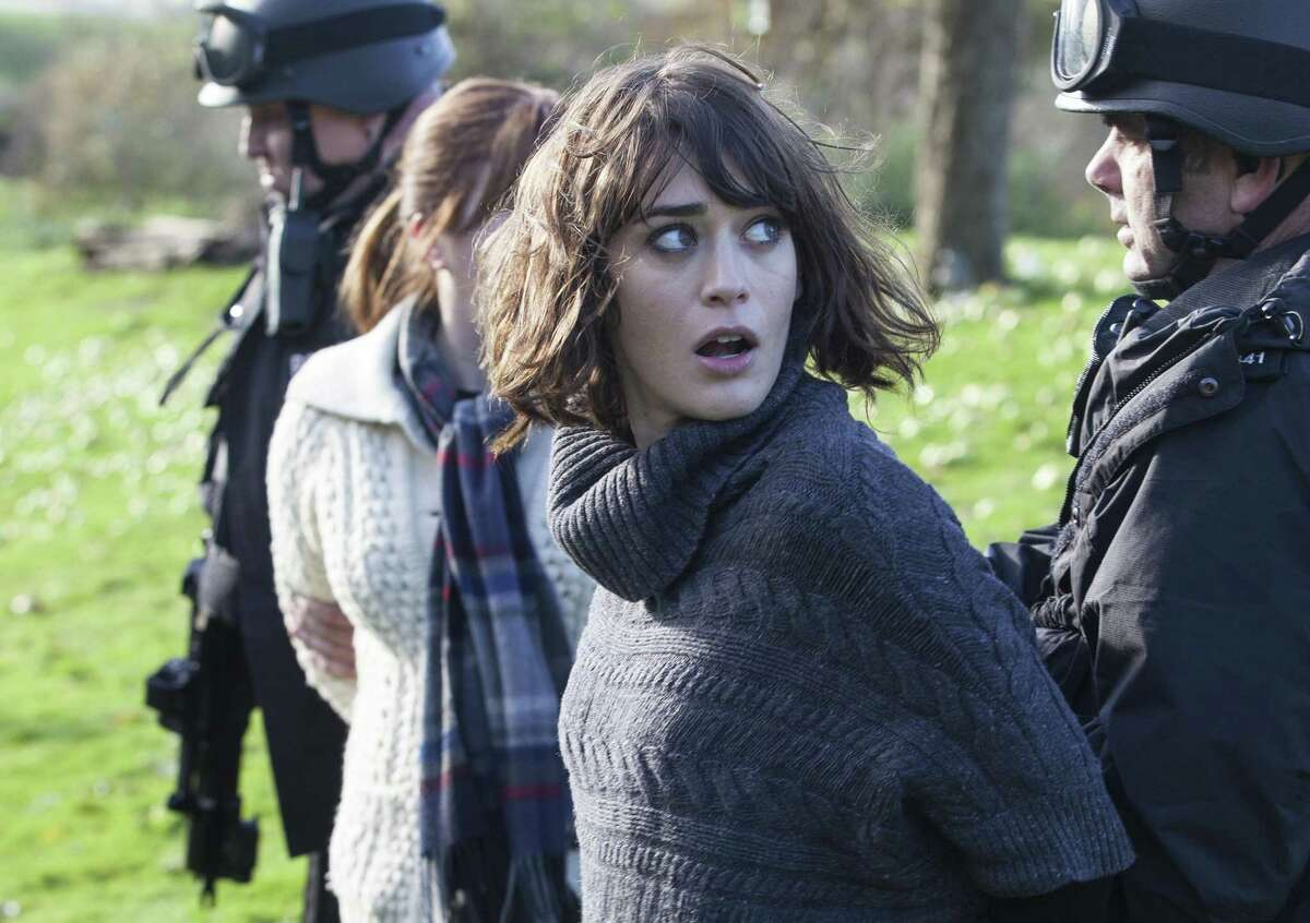 """The wild accomplice: Lizzy Caplan is excellent as the oncologist who's also an alcoholic, substance abuser and sex addict, who helps two friends kidnap and forcibly inject chemo into their dear sick pal in """"Ill Behaviour"""" on Showtime."""