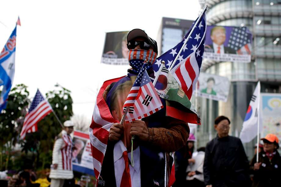 A South Korean conservative takes part in a pro-Trump rally in Seoul on Tuesday during the president's visit. Photo: Woohae Cho