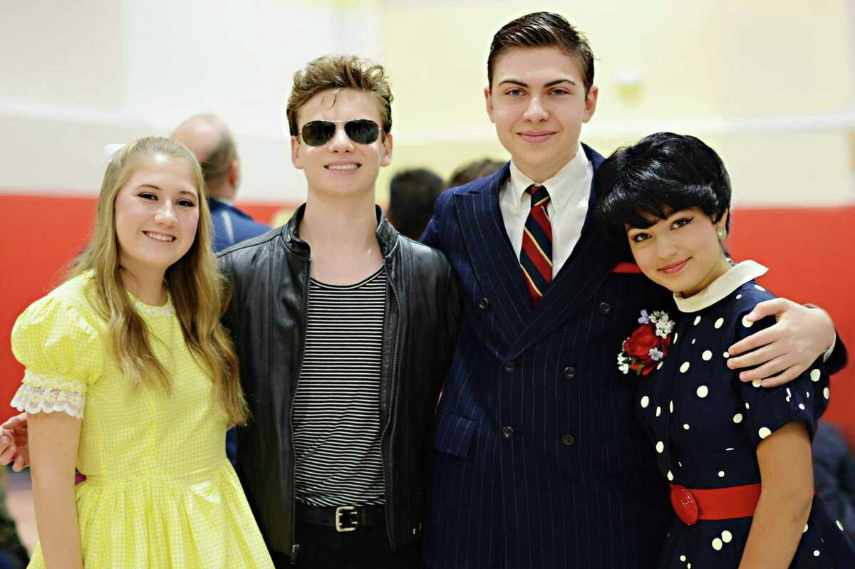 """(From left) Mallory Bennhoff, Ben Dooley, Alessio Pantaleo, Devin Findlay at the New Canaan Chamber of Commerce Halloween Parade in New Canaan, Conn. on Oct. 31, 2017. The New Canaan High School students were portraying their characters in """"Bye Bye Birdie"""" which is being put on in New Canaan High School on Nov. 17 and Nov. 18, 2017."""