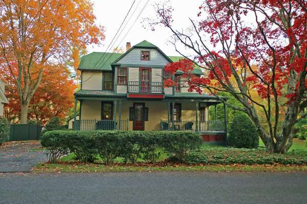 The colonial house at 242 Cedar Road has some of the characteristics of a Victorian.