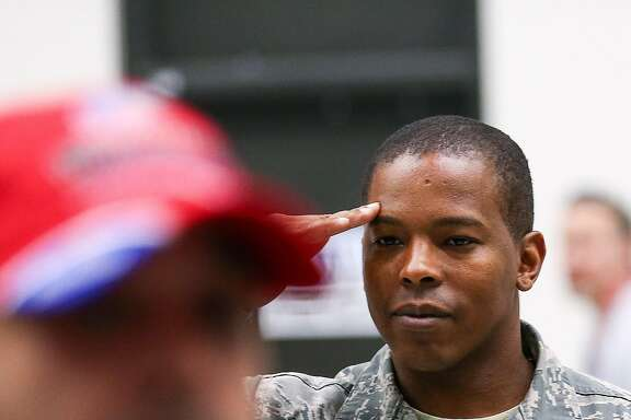 "Air Force Tech. Sgt. John Jack salutes combat-wounded veterans who served in Iraq and Afghanistan, at Bush IAH, Thursday, May 19, 2016, in Houston. The event kicked off ""Warriors Weekend,"" when veterans from around the country participate in a deep-sea fishing trip in Port O'Connor. ( Jon Shapley / Houston Chronicle )"