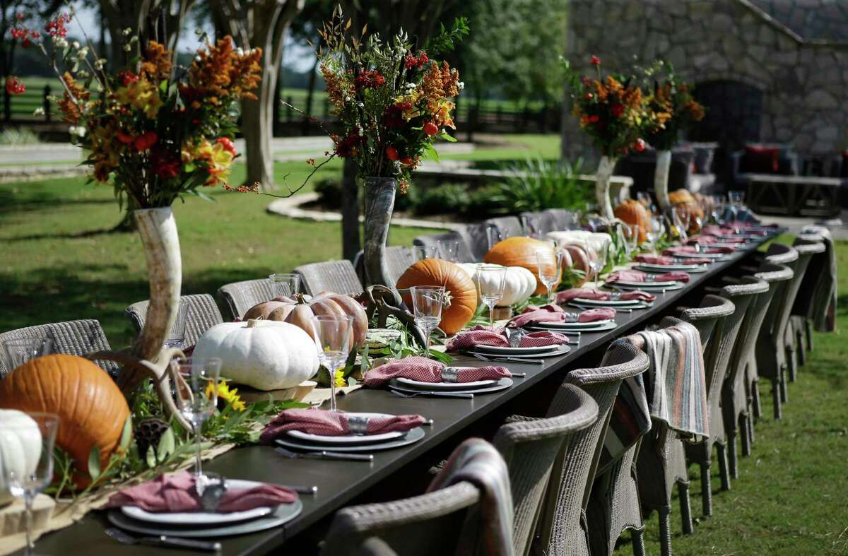 A dining table set for Thanksgiving shown at the country home of Brad and Stephanie Tucker Monday, Oct. 9, 2017, in Waller. ( Melissa Phillip / Houston Chronicle )