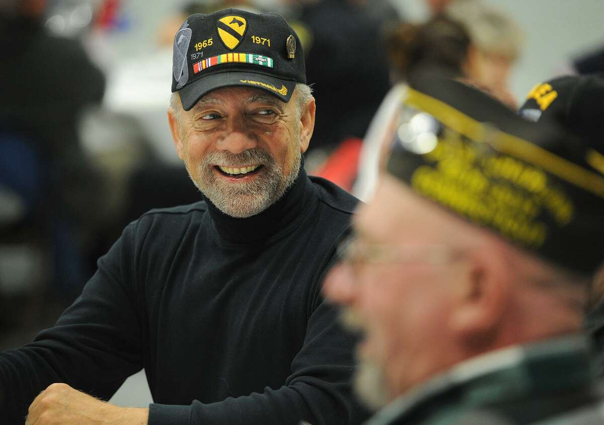 Vietnam veteran Bob Bracci, left, enjoys a gourmet meal prepared by Bunnell High School culinary students as part of a Veterans Day Celebration at the school in Stratford, Conn. on Thursday, November 9, 2017.
