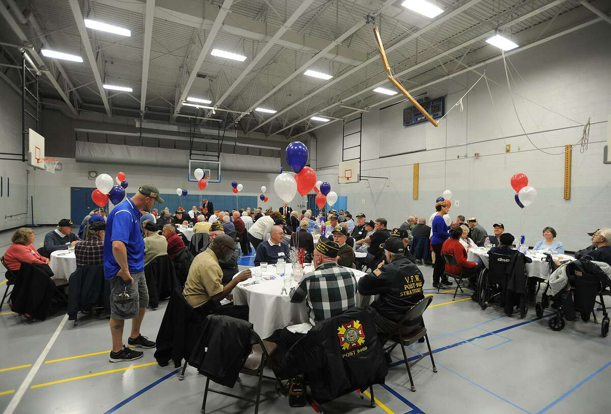 A gymnasium full of Stratford veterans are treated to a gourmet meal prepared by Bunnell High School culinary students as part of the Veterans Day Celebration at the school in Stratford, Conn. on Thursday, November 9, 2017.
