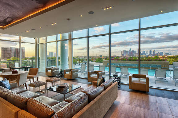 Club level seating in the Southmore in the Museum District looks out to the pool and the cityscape.