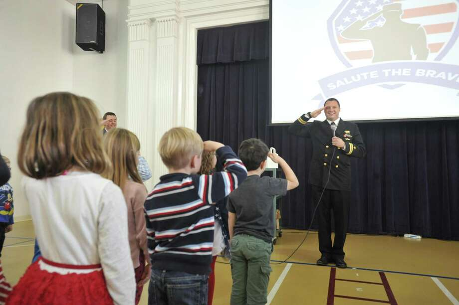 The students of Center School in Litchfield honored and celebrated veterans Thursday with songs and gifts. Photo: Ben Lambert / Hearst Connecticut Media