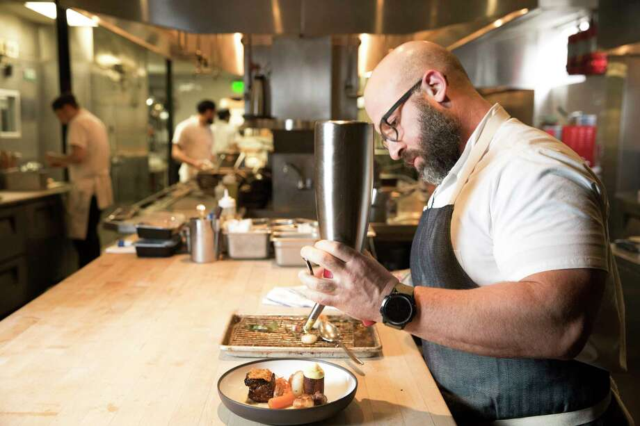 The Pass & Provisions Chef Seth Siegel-Gardner plates the Beef Braised Carrots dish from his fall menu. Photo: Yi-Chin Lee, Houston Chronicle / © 2017  Houston Chronicle