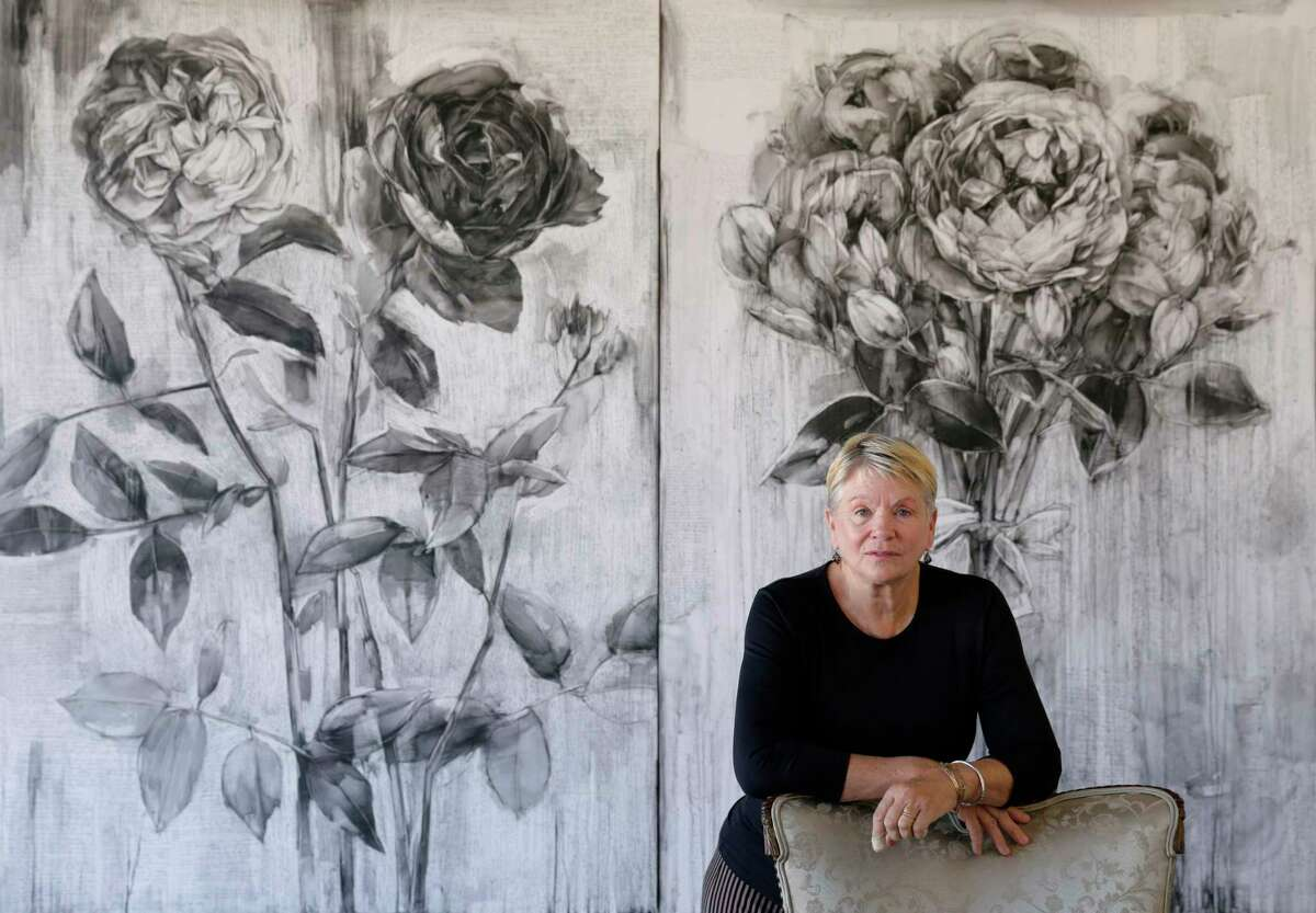 """Artist Karin Broker with two of her works """"Fighting Pretty"""" and """"Picture Pretty"""" (conte on formica)."""