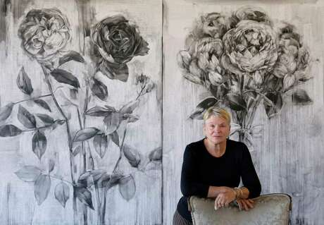 "Artist Karin Broker with two of her works ""Fighting Pretty"" and ""Picture Pretty"" (conte on formica)."