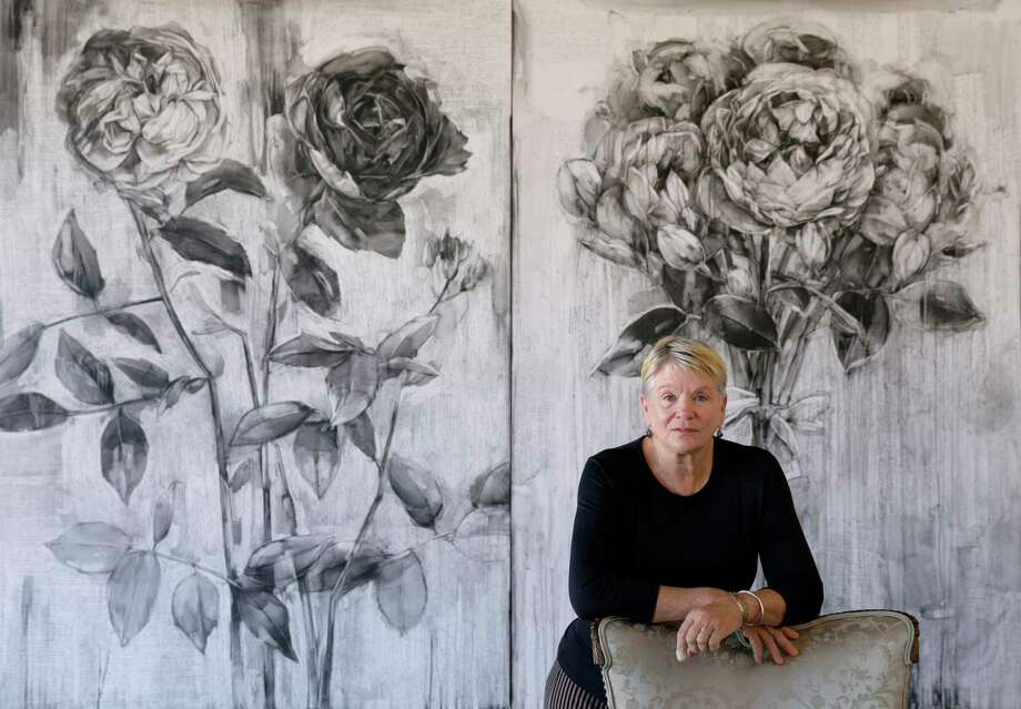 "Artist Karin Broker with two of her works ""Fighting Pretty"" and ""Picture Pretty"" (conte on formica). Photo: Michael Wyke, Freelance / © 2017 Houston Chronicle"