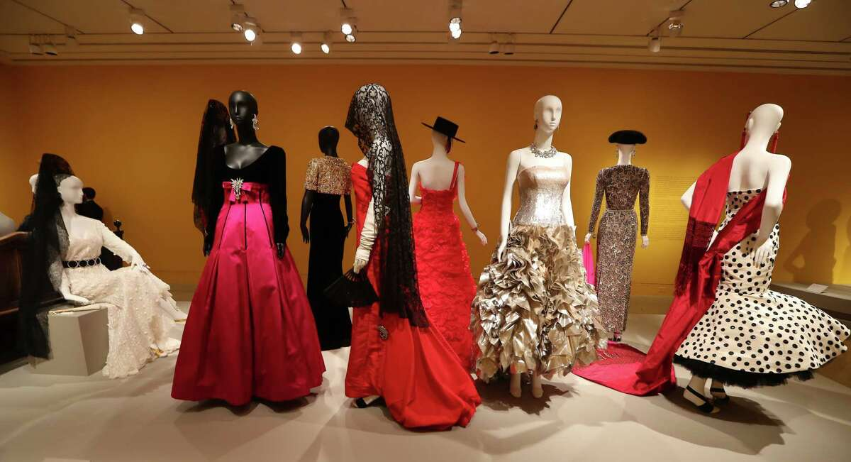 """A display in the Spanish section of """"The Glamour and Romance of Oscar de la Renta includes gowns owned by well-known Houstonians including Lynn Wyatt, Rose Cullen, Yvonne Cormier, Linda McReynolds and Nancy Kinder. It's also where visitors will find the red ballgown Beyonce wore during a Vogue fashion shoot."""