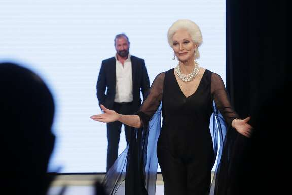 Carmen dell'Orefice reacts as Ralph Rucci presents her with the Texas Legacy award at Heart of Fashion, at Million Air Houston, Wednesday, Nov. 18, 2015, in Houston.  ( Jon Shapley / Houston Chronicle )