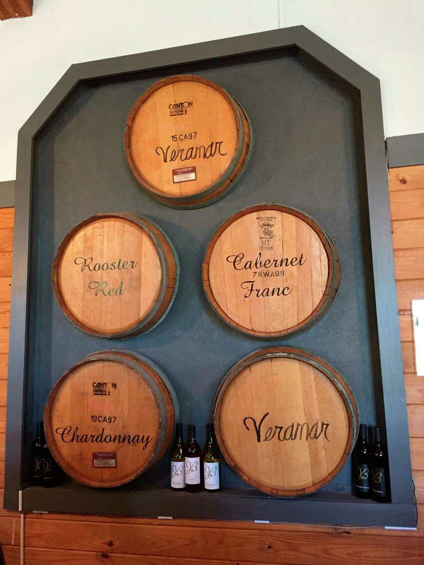 This Sept. 30, 2017 photo shows wine barrel art depicting some of the varietals available at the Veramar Vineyard in Berryville, Va. Thomas Jefferson may have been Virginia's first winemaker but it took another 200 years for the industry to blossom in the state. Today with 300 wineries, Virginia is the country's fifth-largest wine region. (AP Photo/Sally Carpenter Hale) ORG XMIT: NYLS208