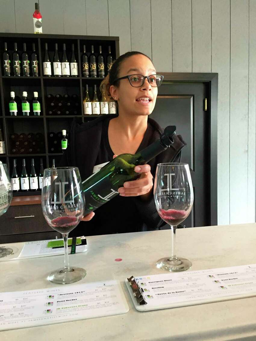 This Sept. 30, 2017 photo shows a server pouring a wine tasting at the James Charles Winery & Vineyard in Winchester, Va. Thomas Jefferson may have been Virginia's first winemaker but it took another 200 years for the industry to blossom in the state. Today with 300 wineries, Virginia is the country's fifth-largest wine region. (AP Photo/Sally Carpenter Hale) ORG XMIT: NYLS202