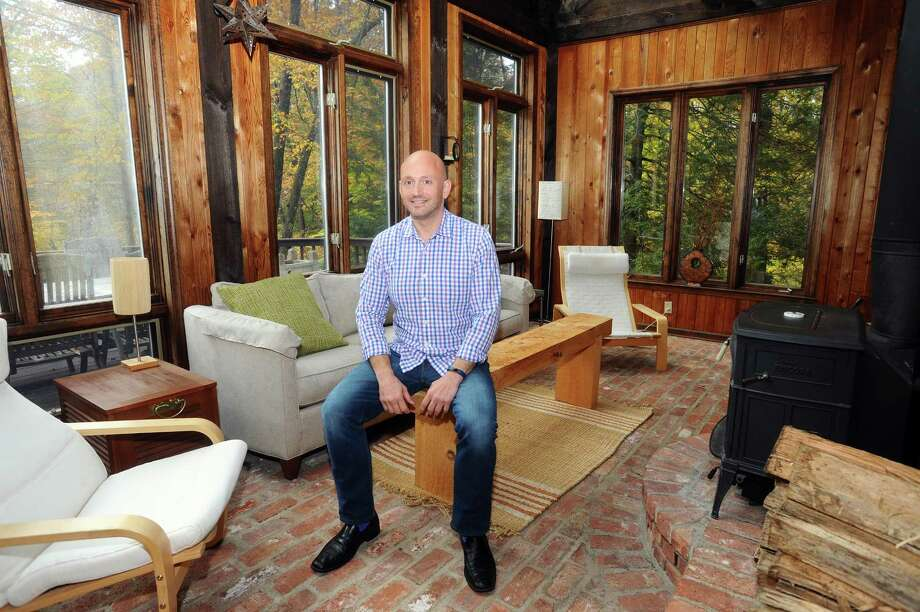 Mike Speaker poses for a photo inside the sunroom of his contemporary home on Blackberry Drive in north Stamford. Photo: Michael Cummo / Hearst Connecticut Media / Stamford Advocate