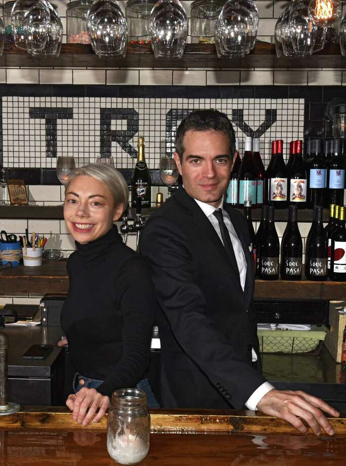 Heather Lavine and Vic Christopher behind the wine bar in their restaurant Lucas Confectionery on Wednesday, Nov. 8, 2017 in Troy, N.Y. (Lori Van Buren / Times Union) Photo: Lori Van Buren / 20042079A