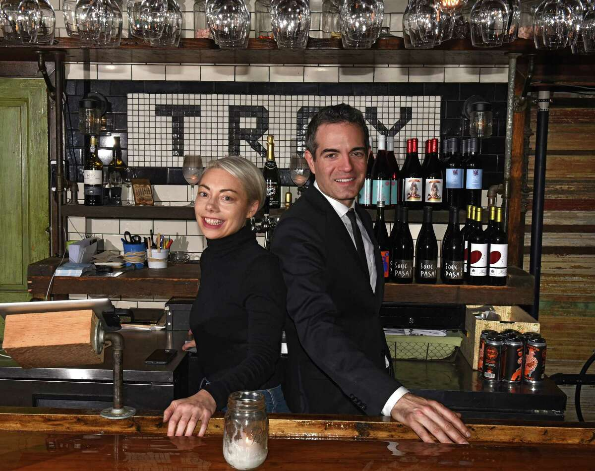 Heather Lavine and Vic Christopher behind the wine bar in their restaurant Lucas Confectionery on Wednesday, Nov. 8, 2017 in Troy, N.Y. (Lori Van Buren / Times Union)