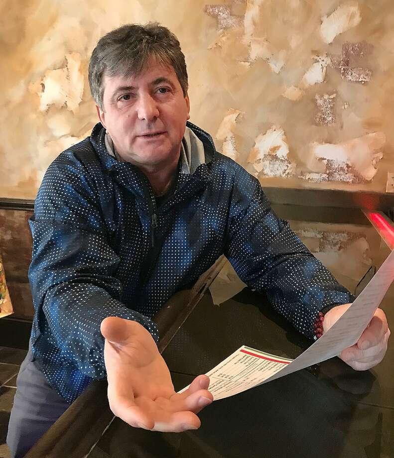 Johnny Merisni Rugova explains the menu at his new restaurant Pasta Giardino in Danbury, Conn., on Thursday, Nov. 9, 2017. Photo: Chris Bosak / Hearst Connecticut Media / The News-Times