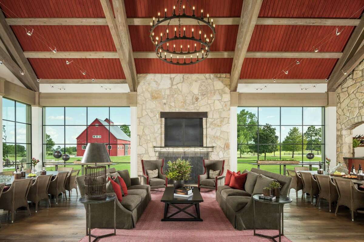 The inside of this great room that the Tuckers use for larger-group entertaining, takes its visual cues from the reconstructed Amish barn seen in the distance.