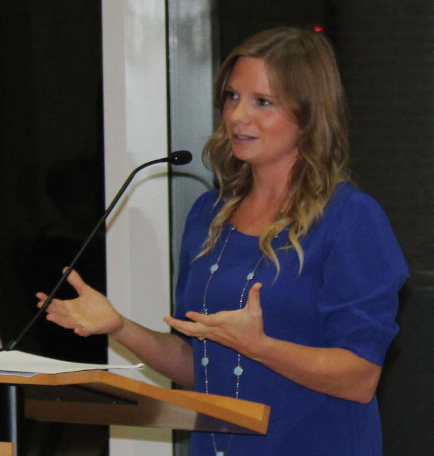 Attorney Amanda Hill speaks about her education experiences at the East Montgomery County Scholarship Foundation gala. Hill received the foundation's scholarship in 2004 when she graduated from Splendora High School and studied at Baylor University. Photo: Jacob McAdams