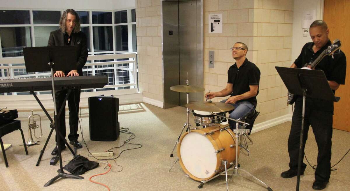 The Jazz Trio provides entertainment for the East Montgomery County Scholarship Foundation gala. The gala was held at the East Montgomery County Improvement District building.