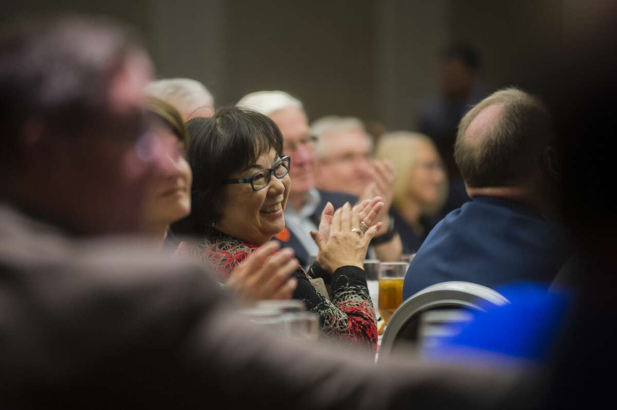 Attendees listen during a live auction of handcrafted furniture at the fifth annual Dine on the Doors charity luncheon for Midland's Open Door on Thursday, Nov. 9, 2017 at The H Hotel. (Katy Kildee/kkildee@mdn.net)