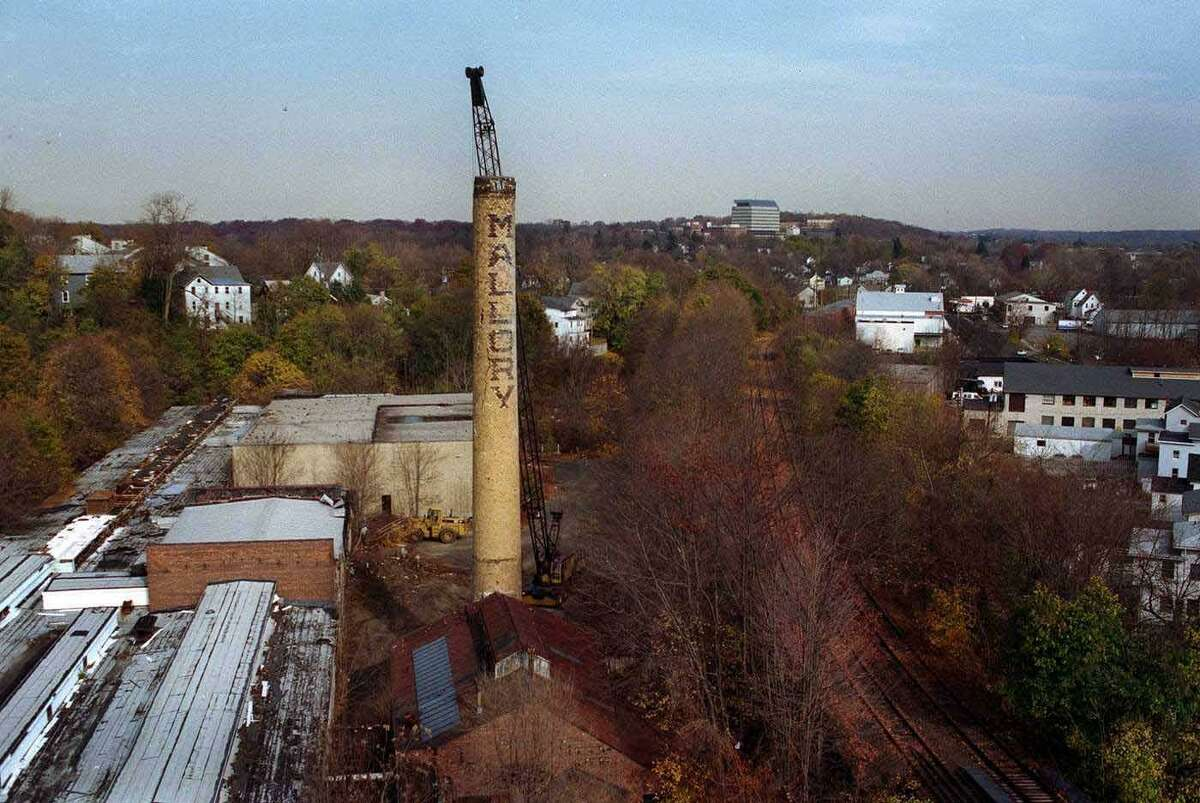 A crane knocks down the smoke stack of the Mallory Hat Factory in Danbury in 1998.