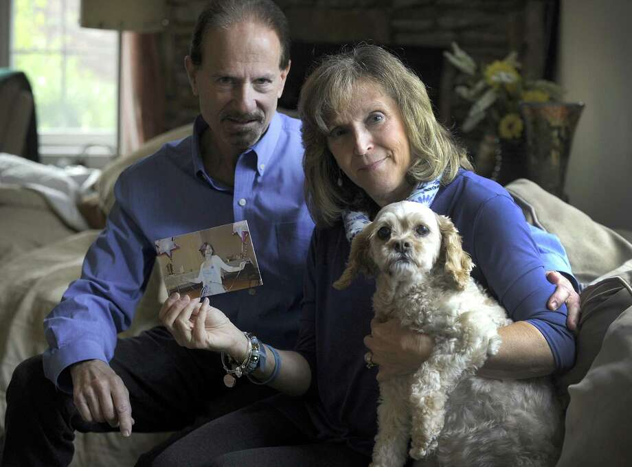 Alan and Debbie Berman's daughter, Alexa, died by suicide when she was 14. The family dog, is Maci, was purchased for Alexa. The Brookfield family now advocates for mental health awareness and education. Photo Thursday, Nov. 9, 2017. Photo: Carol Kaliff / Hearst Connecticut Media / The News-Times