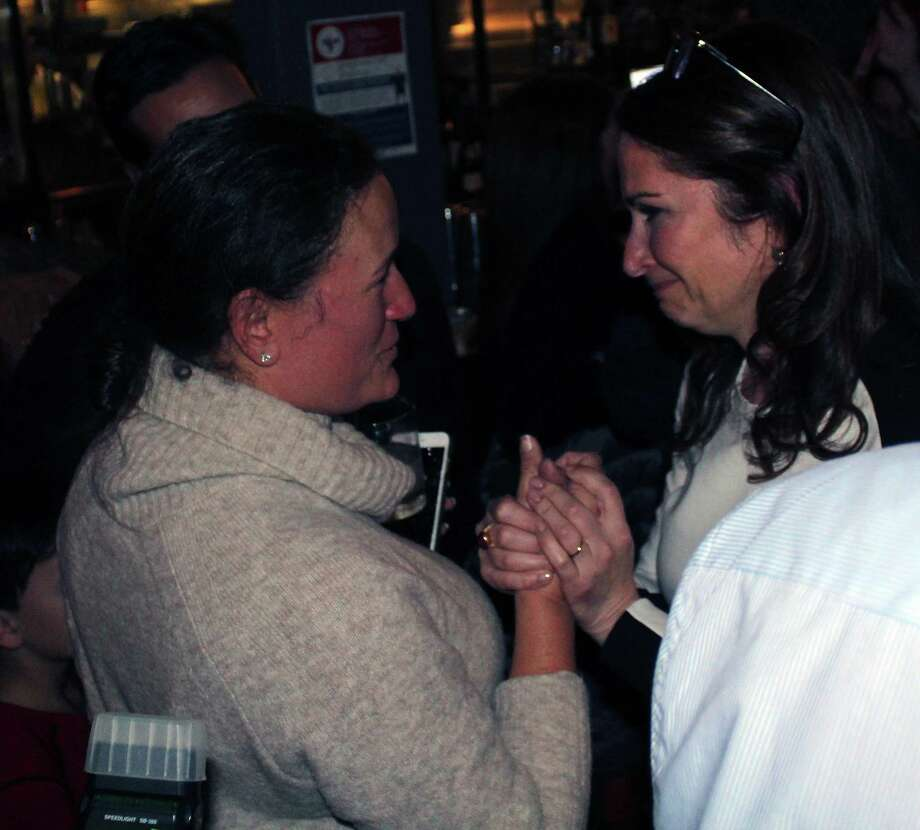 Newly elected Planning and Zoning Commission member, Danielle Dobin, D, and losing First Selectman candidate, Melissa Kane, D, embrace at The Port restauraunt in Westport on election night. Photo: Sophie Vaughan/Hearst Connecticut Media